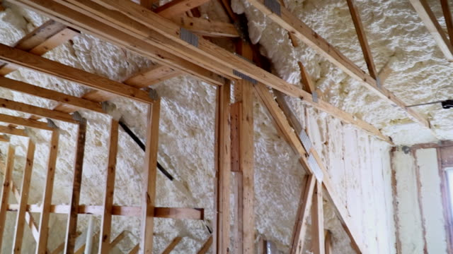 New-home-construction-with-installation-of-termal-insulation-installing-at-the-attic-the-roof