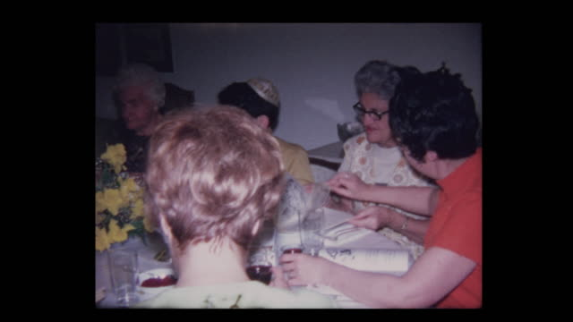 1971-Grandfather-leads-prayer-over-wine-at-Passover-seder