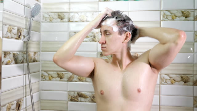 desperate-man-finding-out-that-he-is-loosing-hair-in-shower