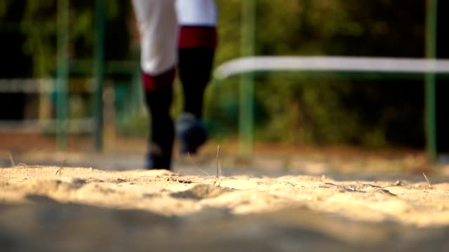 Baseball-player-slides-into-home-base