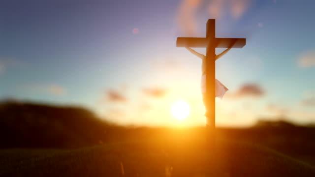 Silhouette-von-Jesus-mit-Kreuz-über-Sonnenuntergang-unscharfen-Hintergrund-Luma-Matte-befestigt