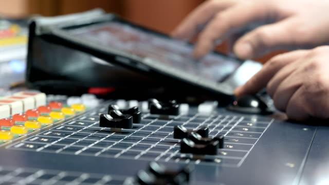 Sound-designer-working-on-the-sound-control