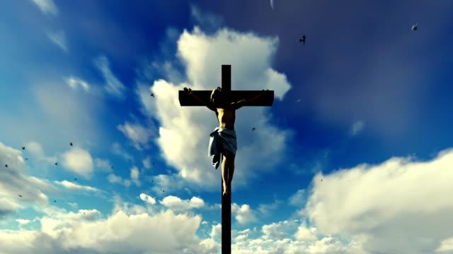 Jesus-cross-against-heavenly-blue-sky-with-pigeons-flying
