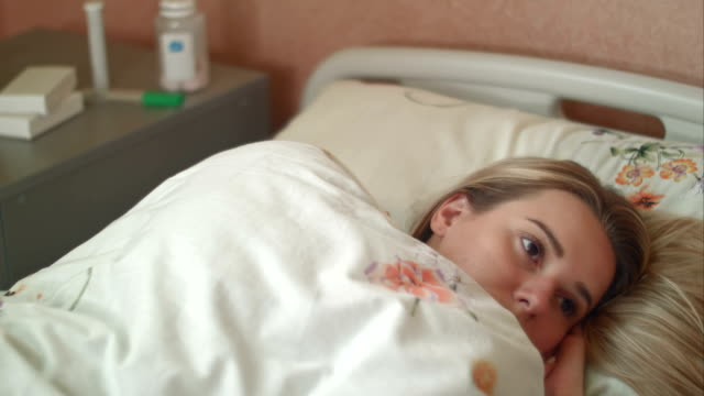 Female-patient-wakes-up-in-a-hospital-bed