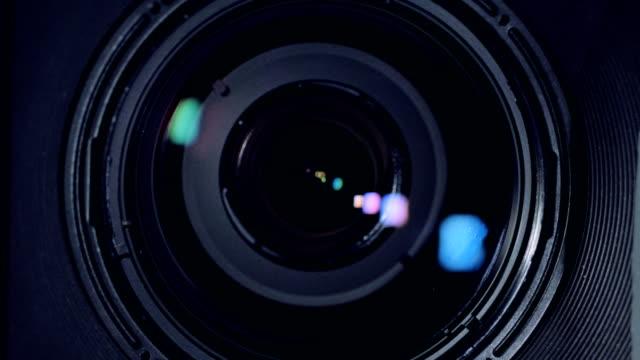 A-macro-view-on-a-black-camera-lens-