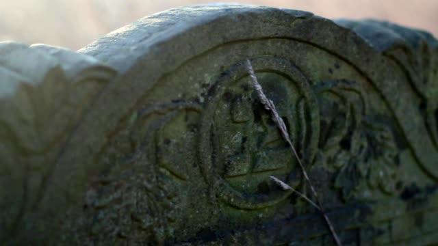 Antique-Gravestones-on-Old-Jewish-Cemetery-at-Sunrise-Steadicam