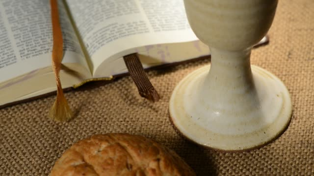 bible-with-chalice-and-bread-panning-sliding-tilt