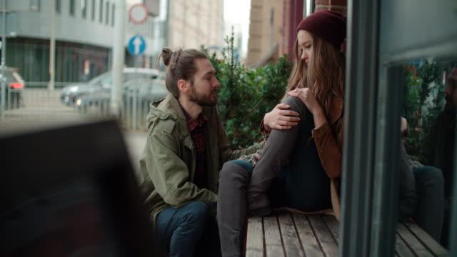Young-man-comforting-sad-woman-