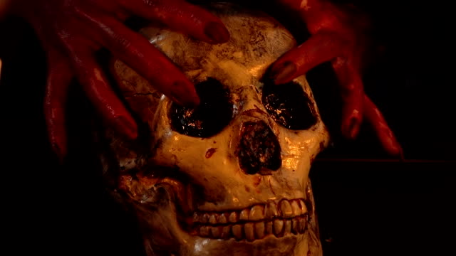 Woman-with-blood-hands-holding-skull
