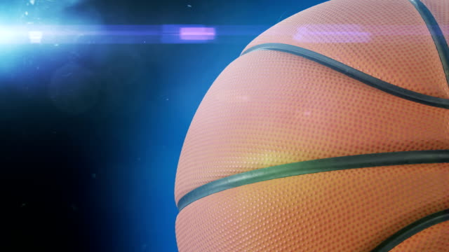 Beautiful-Basketball-Ball-Rotating-Close-up-in-Slow-Motion-on-Black-with-Stadium-Flare-Looped-Basketball-3d-Animation-of-Spinning-Ball-4k-Ultra-HD-3840x2160-