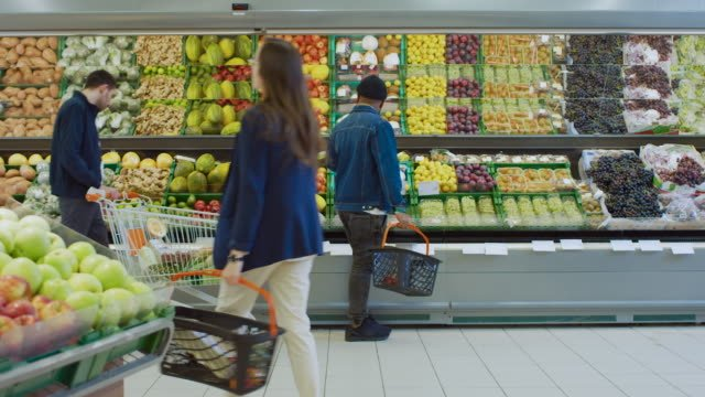 At-the-Supermarket:-Diverse-Group-of-People-Shopping-for-Organic-Fruits-and-Vegetables-in-the-Fresh-Produce-Section-of-the-Store-