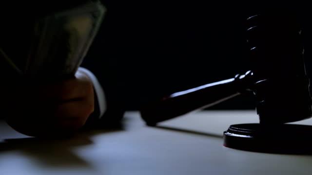 Corrupt-judge-or-auctioneer-counting-money-in-dark-room-black-market-criminal