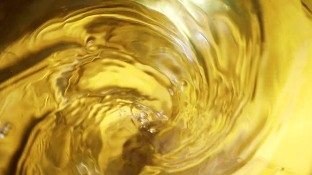 Swirl-of-drink-in-a-glass-in-4k-slow-motion-60fps