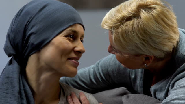Mother-kissing-loving-daughter-with-cancer-supporting-during-chemotherapy