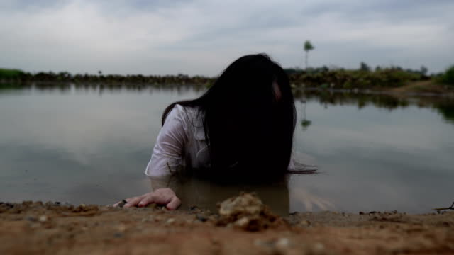 asian-woman-make-up-ghost-face-at-the-swamp