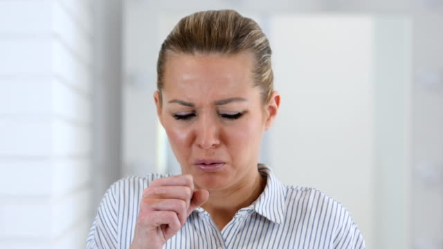 Portrait-of-Sick-Woman-Coughing-Cough