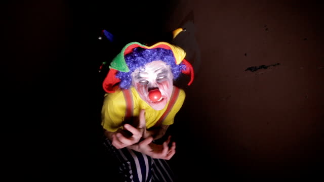 A-scary-clown-in-a-dark-alley-makes-faces-