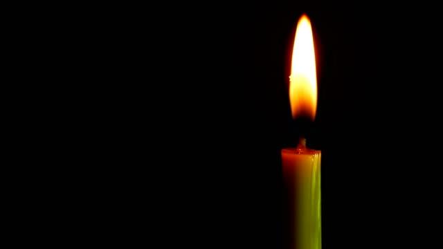 Close-up-candle-is-burning-on-black-background-