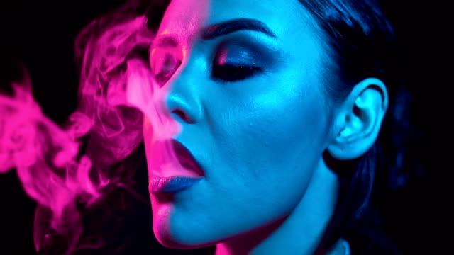 Glamourous-gorgeous-brunette-woman-smoking-electronic-cigarette
