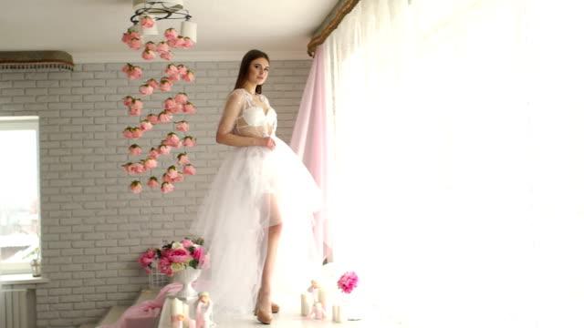 Girl-in-lingerie-and-sheer-fluffy-dress-in-Studio-