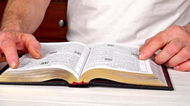 Man-reading-from-the-holy-bible-close-up