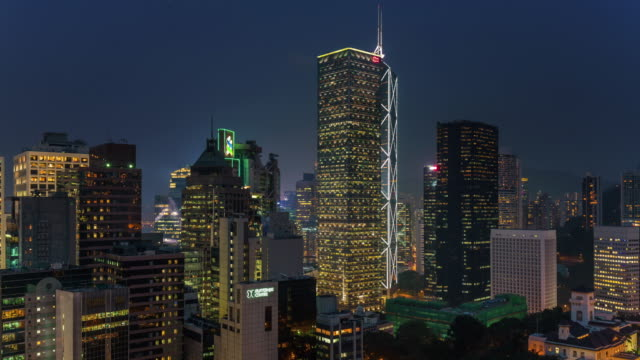 china-day-till-night-light-hong-kong-office-buildings-panorama-4k-time-lapse