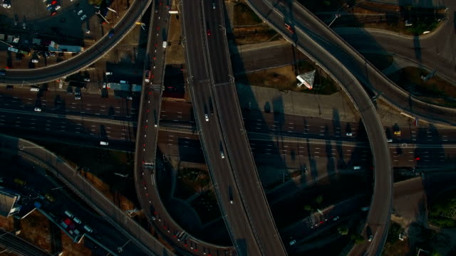 Overhead-aerial-view-of-highway-Road-interchange-Drone-footage