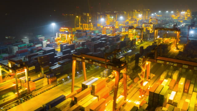 China-noche-iluminada-shenzhen-ciudad-puerto-famoso-panorama-aéreo-4k-timelapse