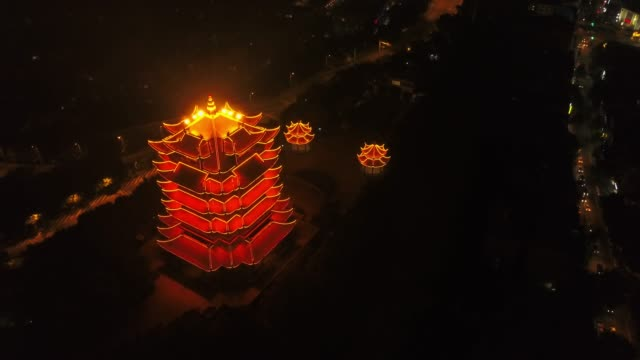 china-night-time-illumination-wuhan-city-famous-yellow-crane-temple-aerial-top-view-4k