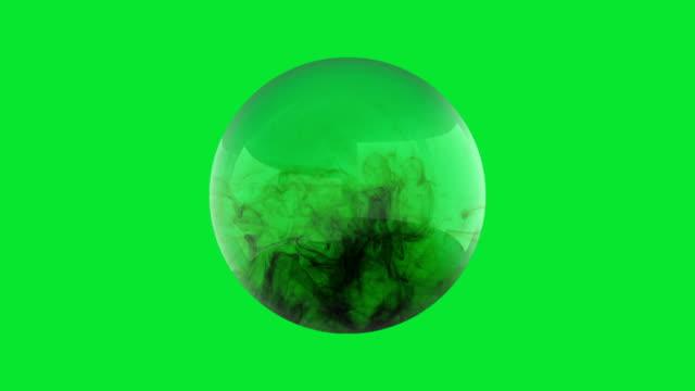 Black-smoke-fills-a-glass-sphere