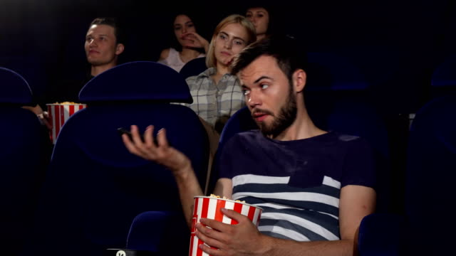 Man-talking-on-his-phone-at-the-movie-theatre