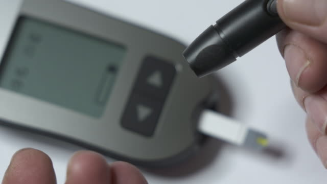Patient-with-diabetes-using-a-blood-glucose-meter-to-test-blood-glucose
