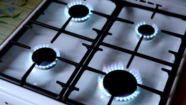 Turns-on-gas-stove-burners