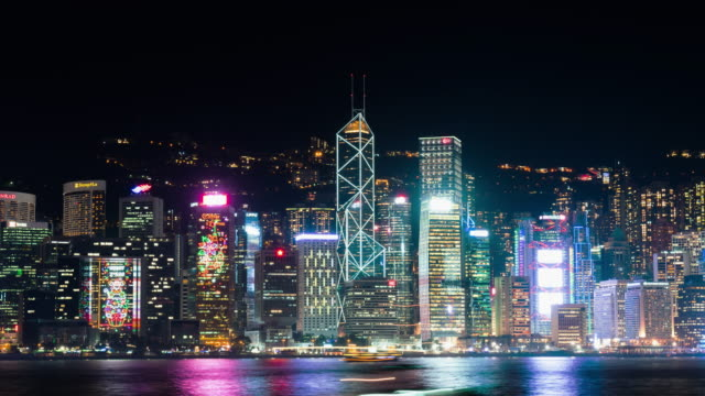 4K-UHD-Time-lapse-cityscape-at-night-of-Symphony-of-lights-show-event-at-Victoria-Harbour-in-Hong-Kong-city-zoom-out-effect