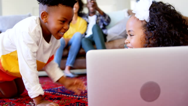 Front-view-of-cute-black-kids-having-fun-in-living-room-at-comfortable-home-4k