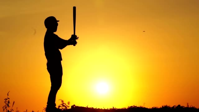 Silhouette-man-with-baseball-bat-to-practice
