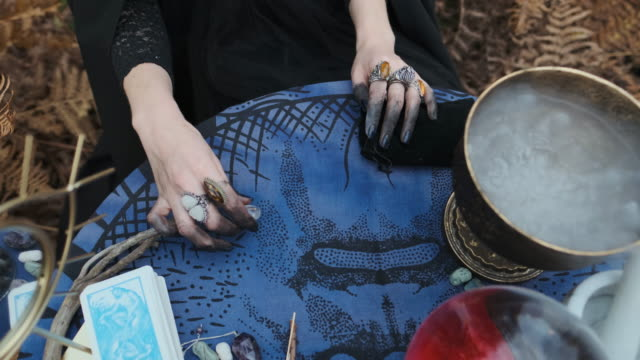 Halloween-Young-Witch-Spells-At-The-Table-