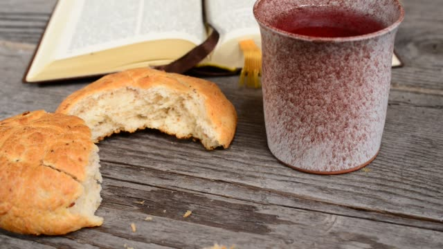 Bible-with-Chalice-and-Bread-Shot-with-Slider-Tilt-