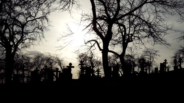 Halloween-background-Old-Graveyard-with-Ancient-Crosses-at-sunset