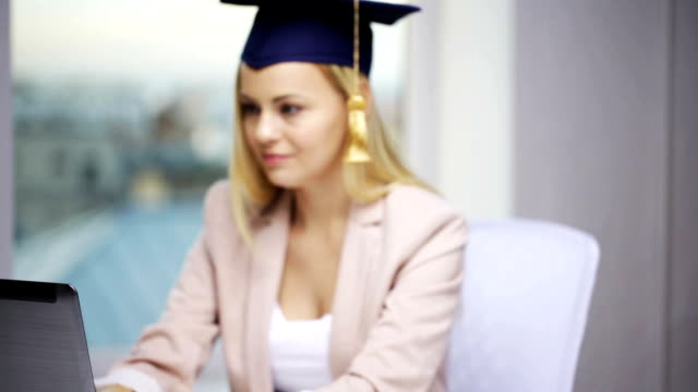 student-girl-in-bachelor-cap-showing-diploma