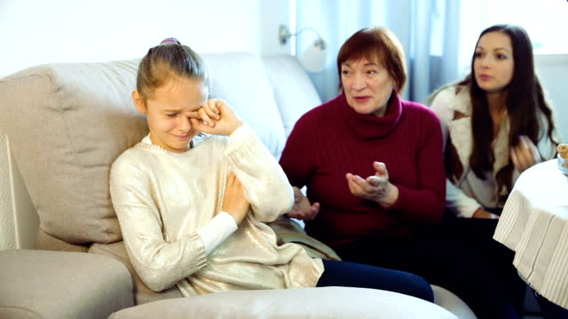 Little-girl-crying-while-mom-and-granny