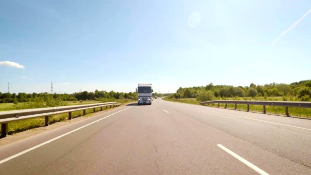 Truck-is-traveling-along-the-roads-of-Europe-Front-View-of-White-Semi-Truck-on-Road