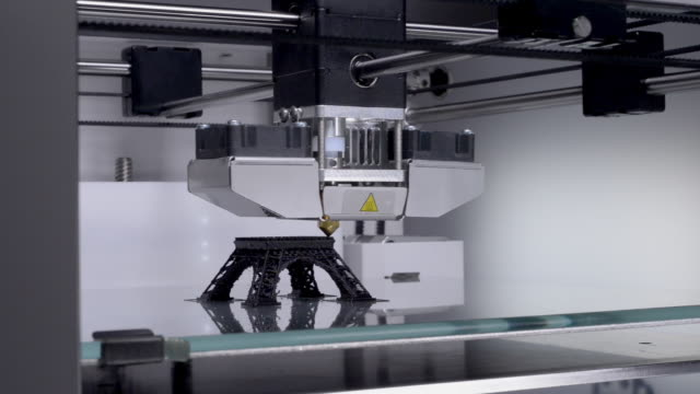 3D-printer-working-printing-a-model-of-the-Eiffel-Tower---industrial-revolution