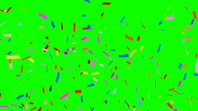Multi-colored-confetti-falling-on-green-