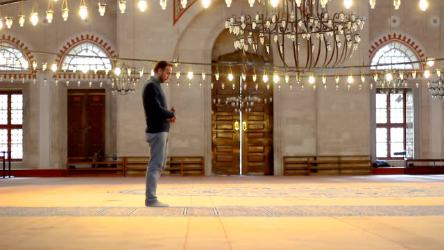 Young-muslim-praying-in-mosque