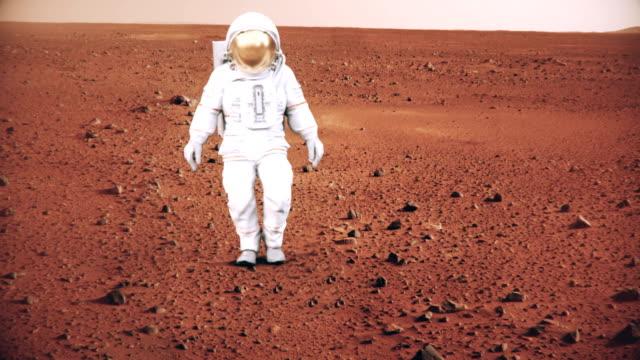4-K-astronauta-caminando-en-la-superficie-de-Marte-(Elementos-de-fondo-proporcionados-por-la-NASA)-