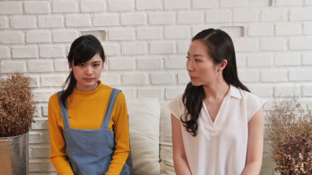 Asian-family-Mom-and-teenage-daughte-are-feeling-stressed-and-angry-not-talking-after-dispute-at-home-Family-conflict-concept