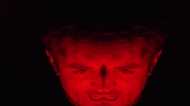 Scary-shots-of-a-man-possessed-with-rage-screaming-and-upset-Horror-anger-paranormal-and-Halloween-concepts-Shot-on-Red-Camera-No-cut-to-black-variation-