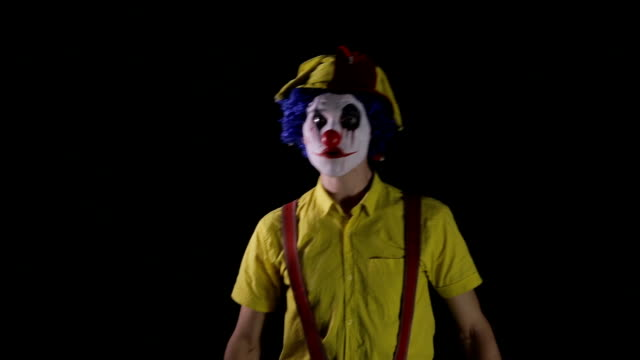 A-scary-clown-makes-fast-head-and-torso-movements-