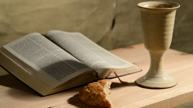 bible-with-chalice-and-bread-panning-sliding